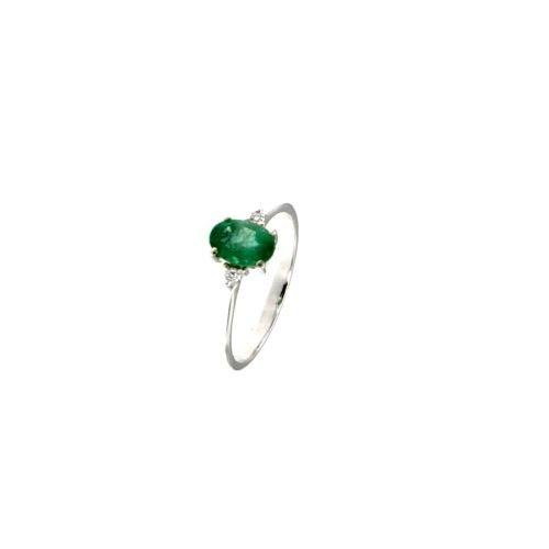 Anello in oro bianco con diamanti e smeraldo