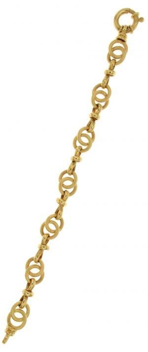 Bracciale in oro con particolare gioco di treccia e anelli
