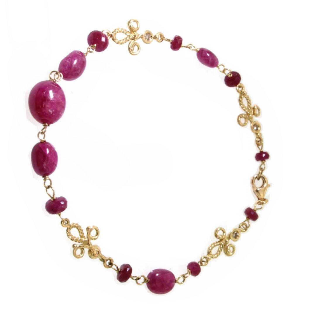 Bracciale in oro giallo con rubini naturali e diamanti