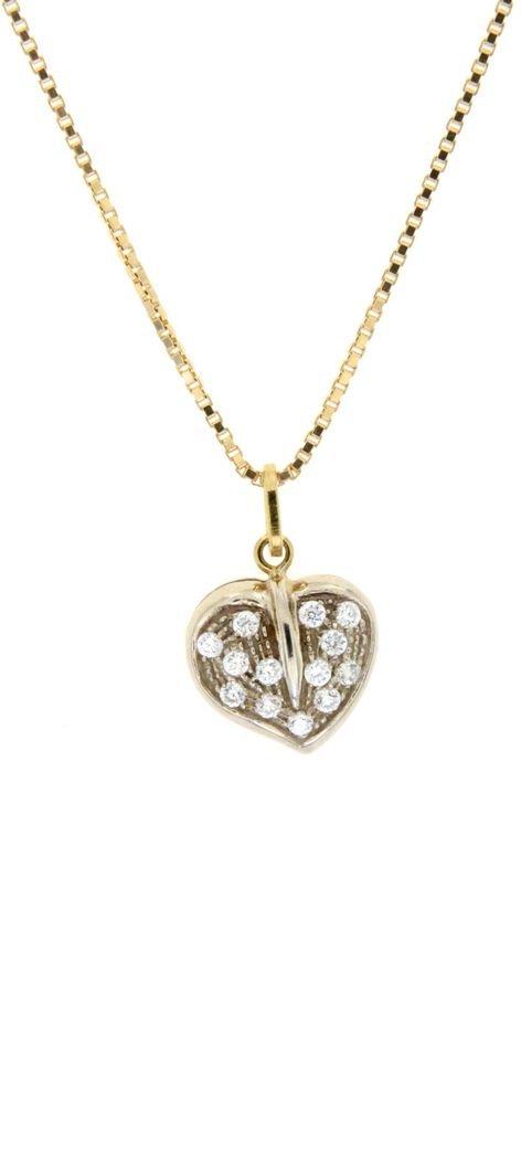 Ciondolo in oro a forma di cuore con zirconi