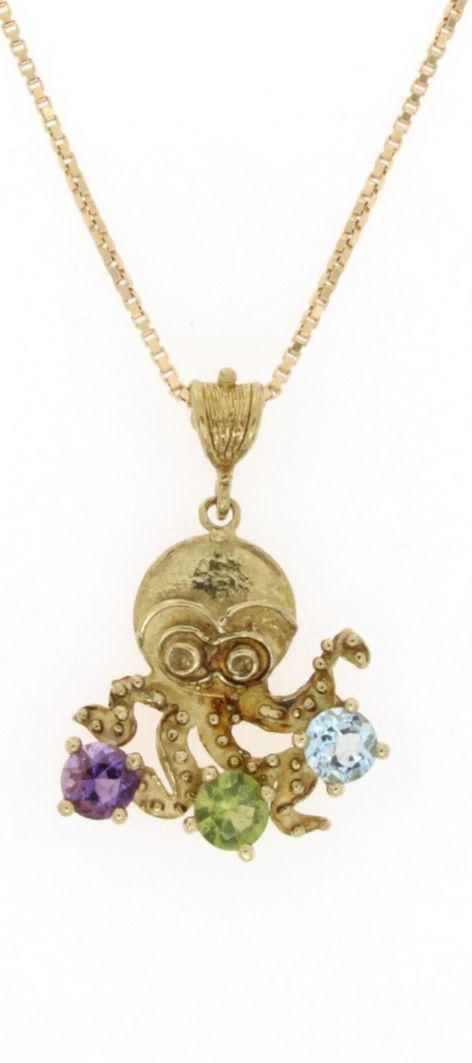 Ciondolo in oro raffigurante un polipo con ametista peridoto e topazio azzurro
