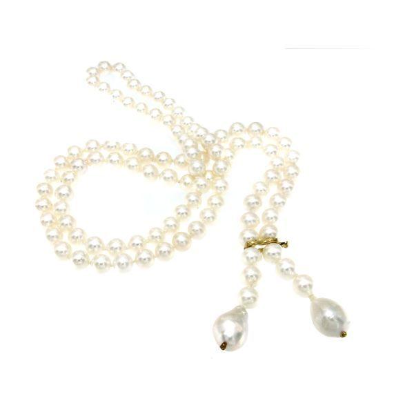 Collana lunga di perle di mare e brillanti