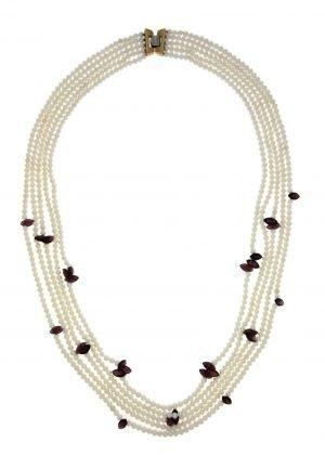 Collana multifilo di perle coltivate di mare con inserti di granato naturale